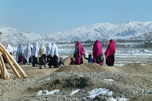 Women and children on their way to a winter-time wedding in Bamyan