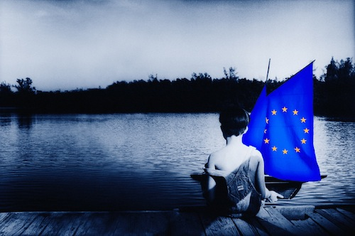 Child with European boat - source EU