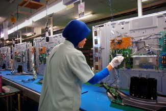Worker in factory - source ILO
