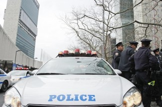 NYPD officers stage their vehicles in front of United Nations Headquarters, preparing for a counter-terrorism drill.