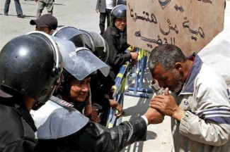 Egypt activist and police - source UN
