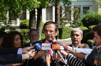 Samaras with media