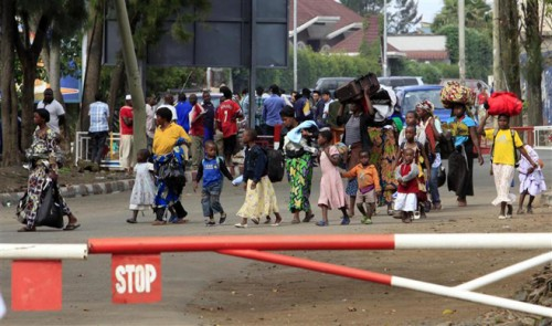 Displaced people cross the border from the Democratic Republic of Congo into Rwanda, as seen from Gisenyi