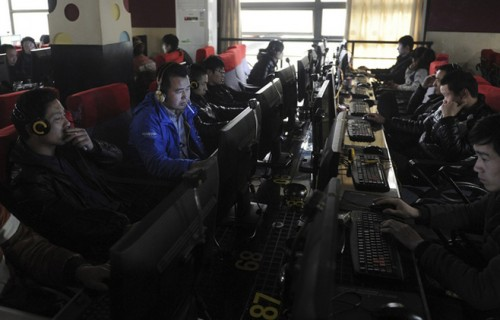 Customers use computers at an internet cafe in Hefei