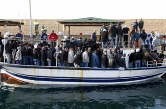 2011_Italy_boatmigrants-500x332